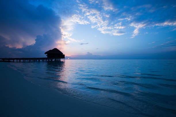Dawn Silhouette of Water Villa stock photo