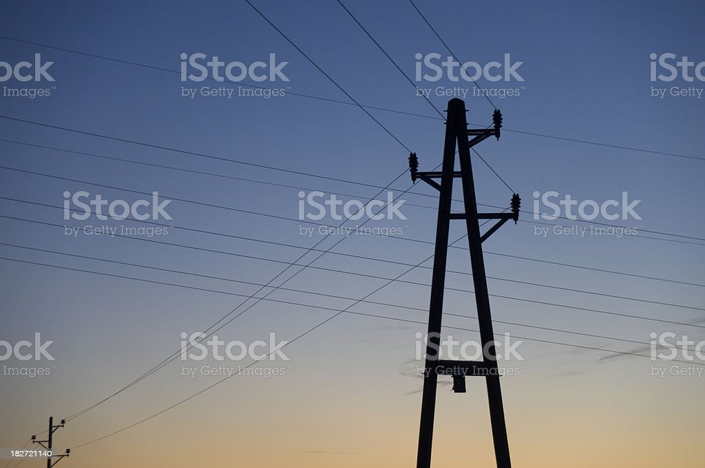 Dawn winter landscape with power pole stock photo
