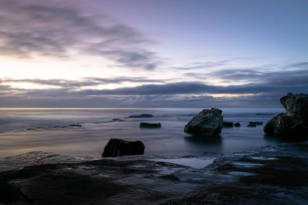 Dawn_colours_tranquil_beach_1 stock photo