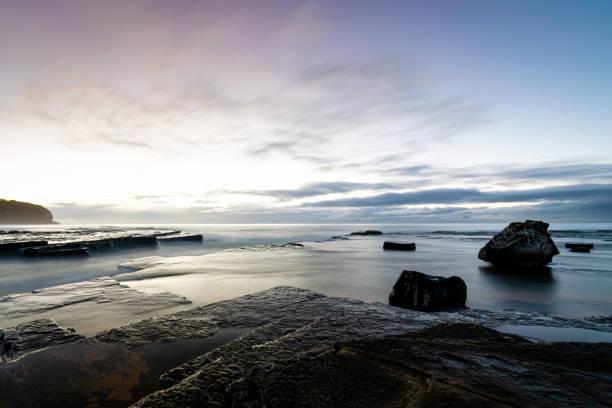Dawn_colours_tranquil_beach_2 stock photo
