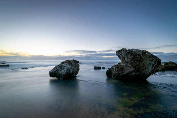 Dawn_colours_tranquil_beach_3 stock photo