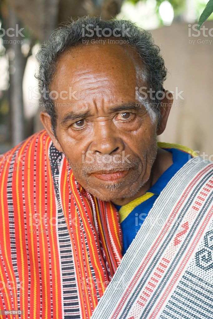 Dawon elder with colorful traditional textiles. royalty-free stock photo