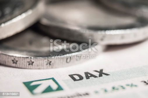 A macro shot of a dax sign with euro coins.