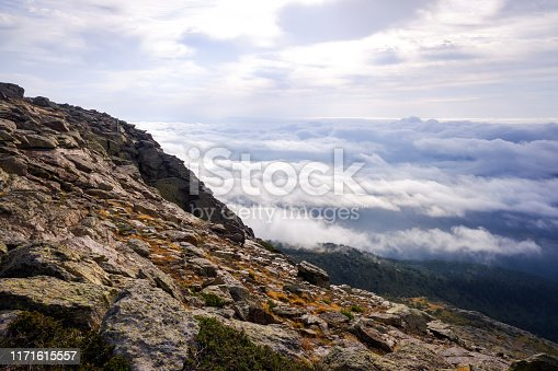 A day above the clouds at the top of the Peñarala mountain in Madrid, a mountaineering and adventure excursion.