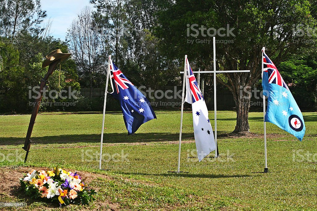 ANZAC Day Army Rifle, Slouch hat & Australian Service flags stock photo