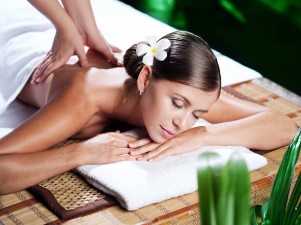day in spa - thai massage stock photos and pictures