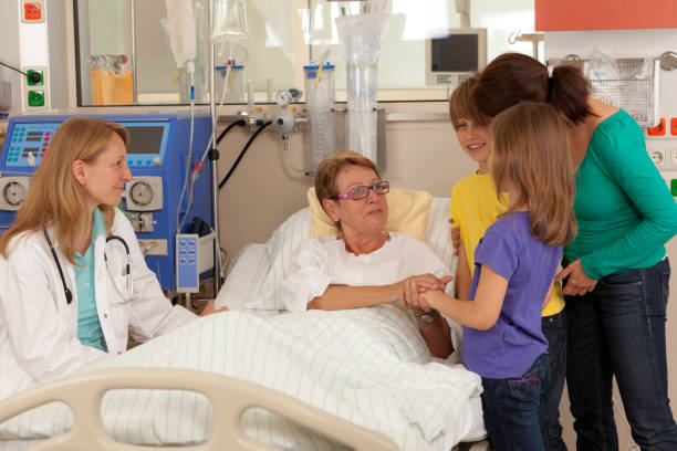 Day in the Life of a Patient, visiting woman in hospital stock photo