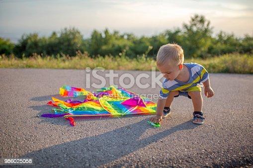 Toddler playing with kite