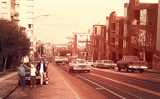 Vintage image of a mother and her children on the streets inSan Francisco in seventies/eighties of the 20th century.