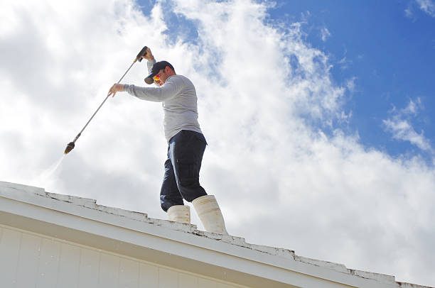 day laborer pressure cleaning a roof - high pressure cleaning stock photos and pictures