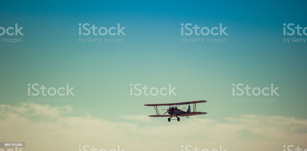 Day of the Air Fleet. Biplane in the sky royalty-free stock photo