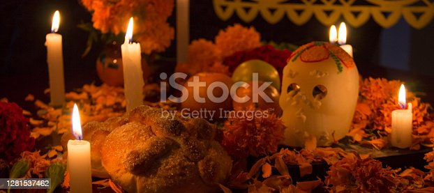 Altar with candles, cempasuchil flowers, sugar skull and bread. authentic mexican tradition.