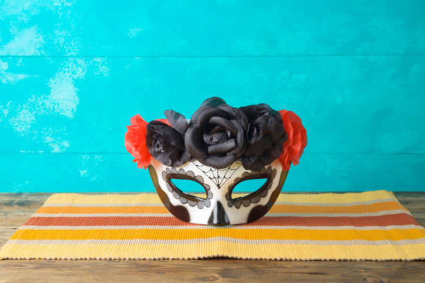 Day of the dead, Dia De Los Muertos, holiday concept with sugar skull mask on wooden table stock photo