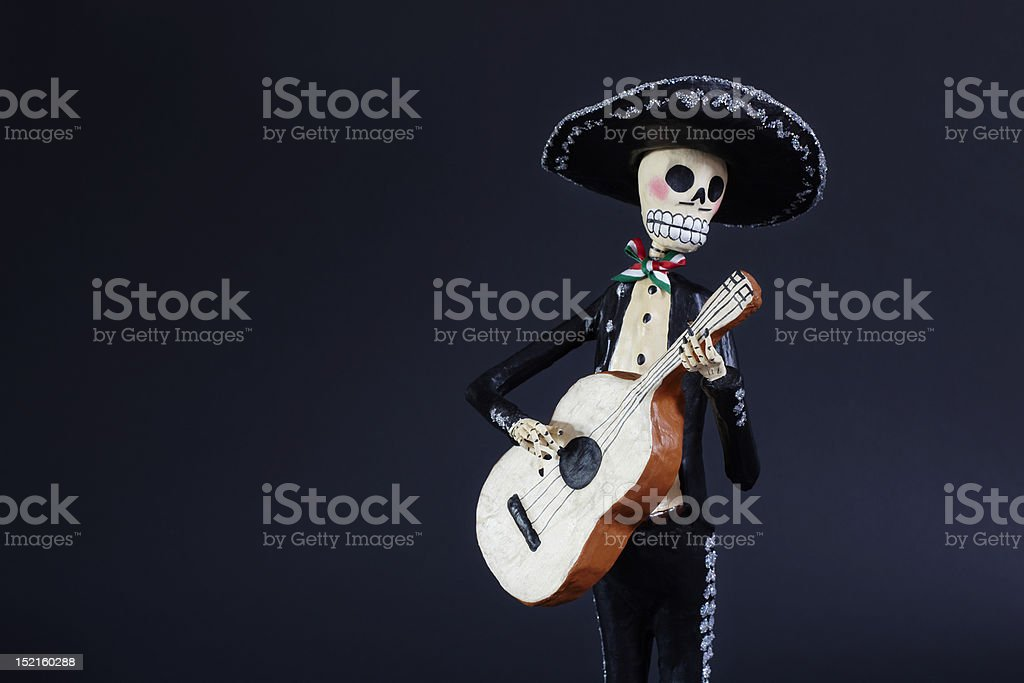 Day of the Dead doll Mariachi Guitarron player stock photo
