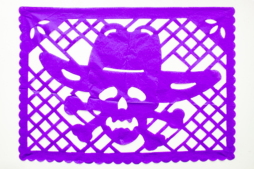Day of the Dead, Papel Picado. Purple Real traditional Mexican paper cutting flag. Isolated on white background.