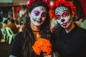 Portrait of a mother and daughter with traditional make up for Dia de los Muertos, Mexico