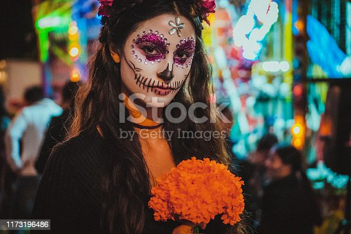 Portrait of a woman with traditional make up for Dia de los Muertos, Mexico