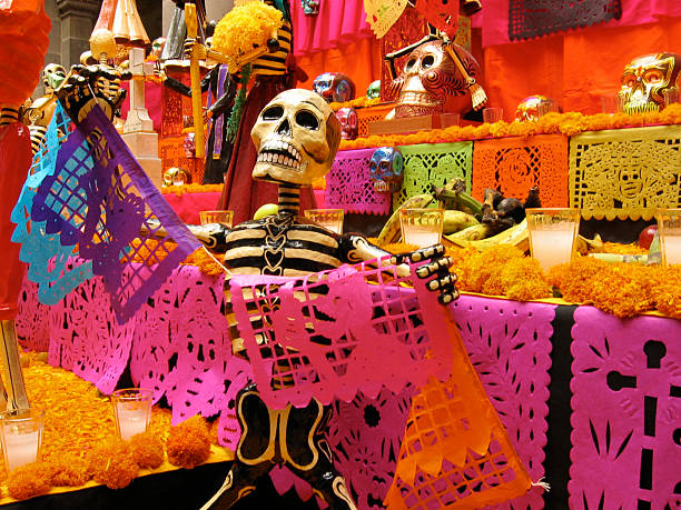 Día de Muertos One of the many colorful altars that are put up yearly to celebrate the dead in Puebla, Mexico. puebla state stock pictures, royalty-free photos & images