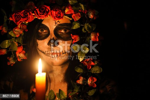 Woman's face with ceremonial make-up also known as Sugar skull, used in traditional Mexican Dia de los Muertos celebration.