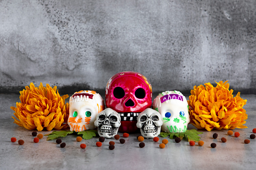 Day of the dead traditional Mexican skulls arrangement with space for copy
