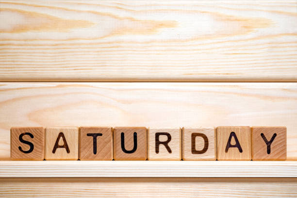 day of the week. saturday made from vintage wooden cubes. day off idea. week day concept. working day. business concepts. name of the week. small business concept. part of series. copy space - small business saturday stock pictures, royalty-free photos & images