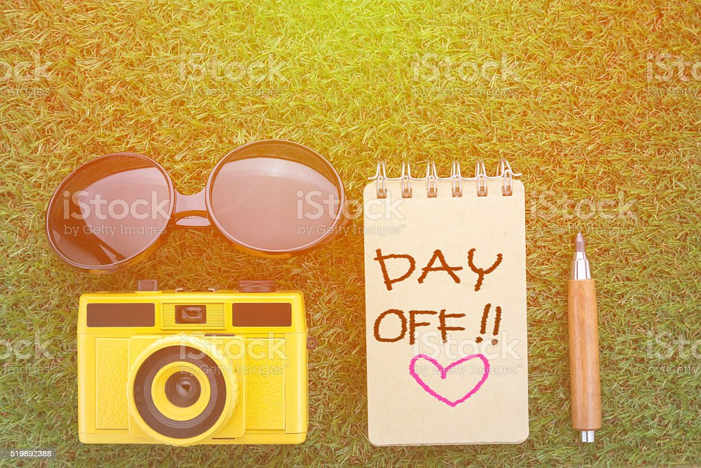 day off concept with sun glasses notebook camera stock photo