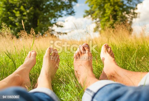 Couple relaxing in the meadow.
