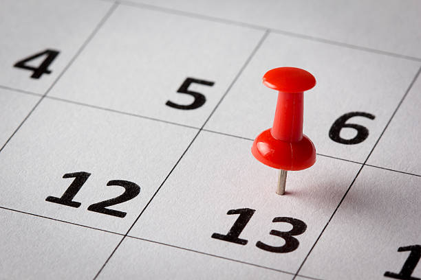 Day on calendar marked with a red thumbtack stock photo