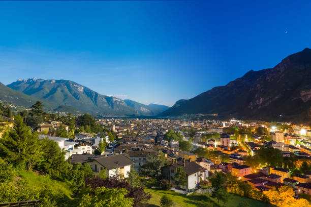 day to night transition in  mountain town stock photo