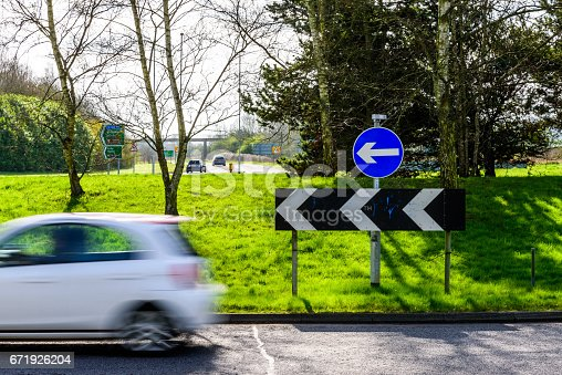 istock Day view of busy traffic on UK Motorway roundabout 671926204