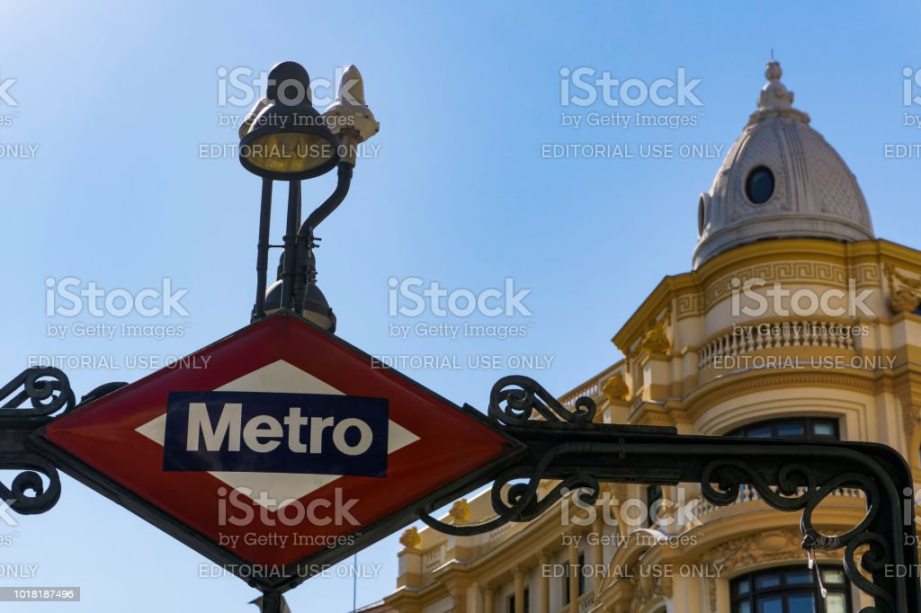 Day view of Metro de Madrid over ground rhomboid sign with light above at station entrance. stock photo