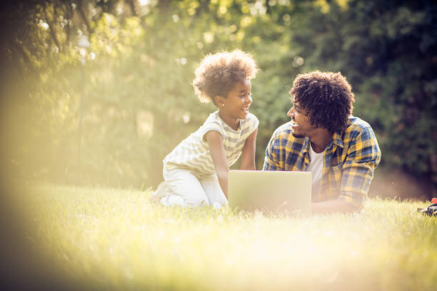 Day with computer in park. stock photo