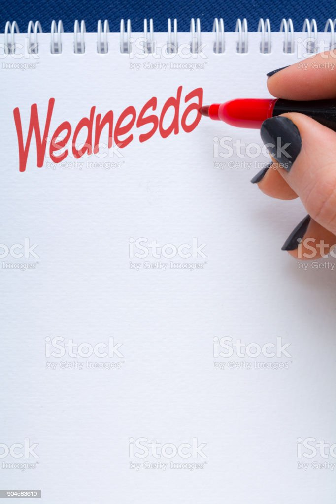 day written on notepad with red marker with copy space below stock photo