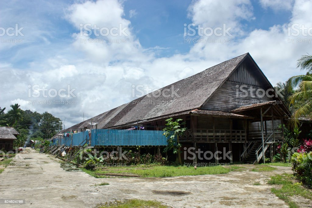 Dayak Iban longhouse or Rumah Betang in Sui Utik, Batu Lintang Village, district of Kapuas Hulu, West Kalimantan, Indonesia were built with thick wood and inhabit for almost 300 hundred people who lived inside the longhouse and divided into 28 rooms. stock photo