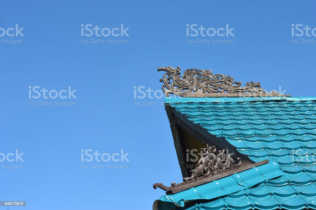 Dayak ornaments on the traditional tribal carvings at the roof top of buildings stock photo