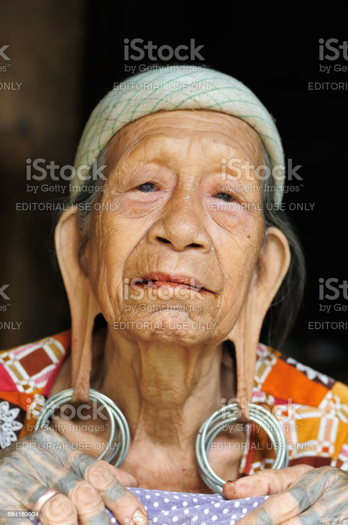 Dayak women with traditional long ears. stock photo
