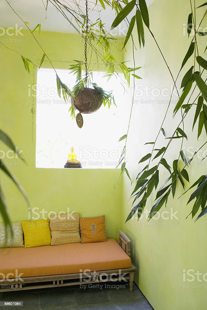 Daybed in green room with plants royalty-free stock photo