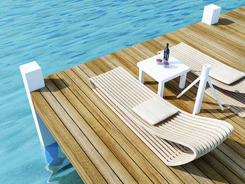 daybed on wood floor in the sea, travel of summer conception