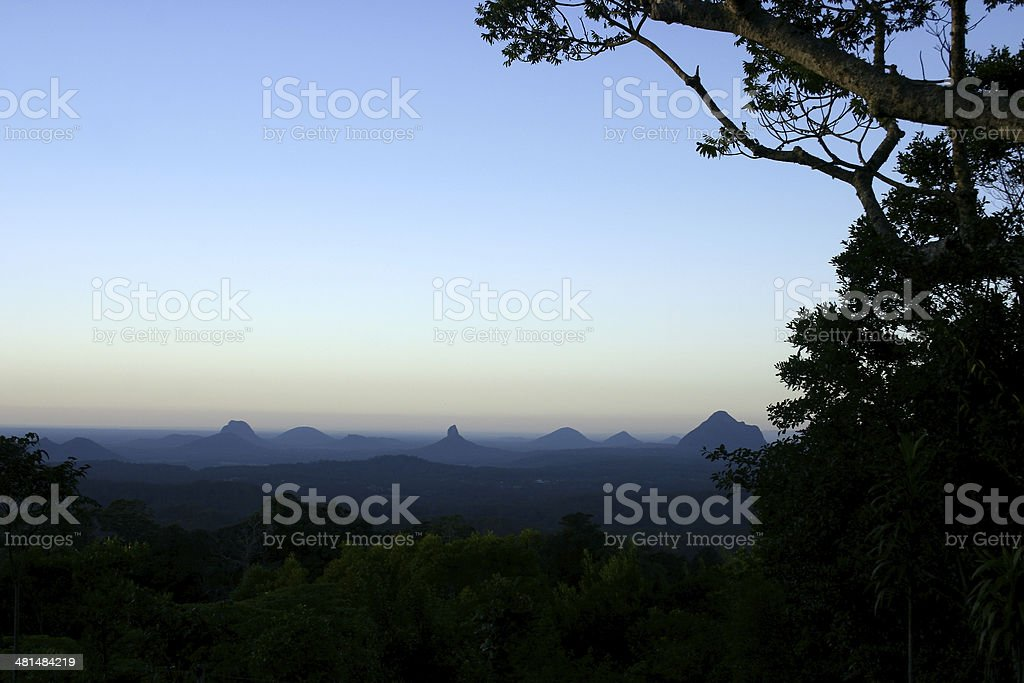 Daybreak with Mist surrounding Mountains stock photo