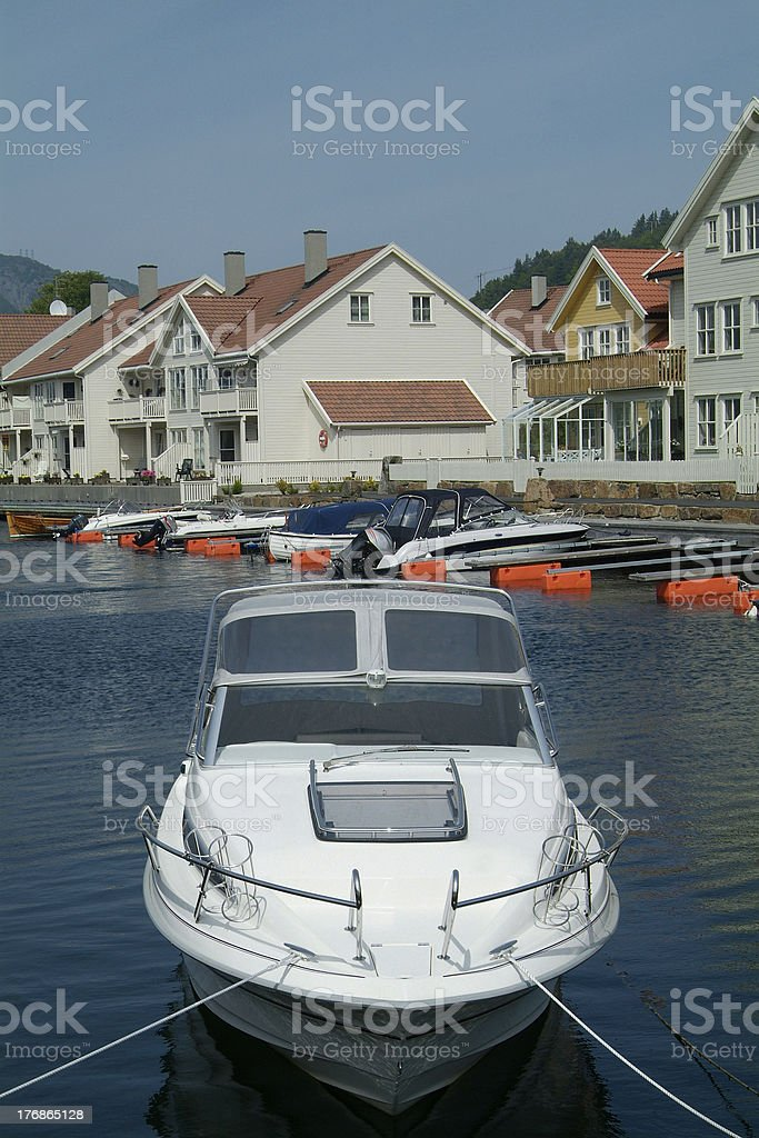 Day-cruiser and water-front houses stock photo