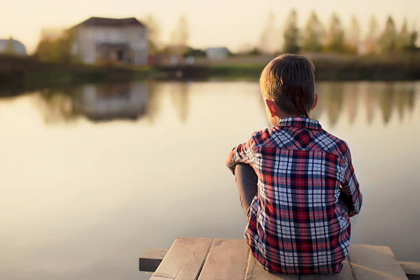 936 Little Boy Sitting Alone At River Stock Photos, Pictures & Royalty-Free Images - iStock