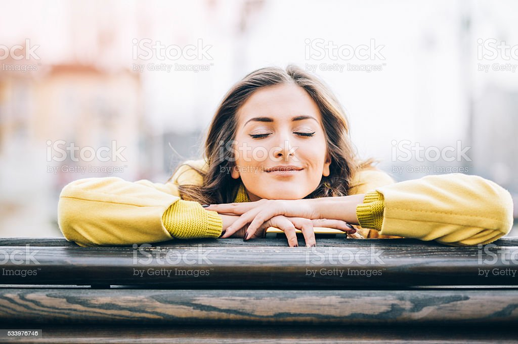 Daydreaming and enjoying the sunlight stock photo