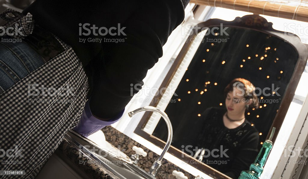 Daydreaming at the kitchen sink royalty-free stock photo