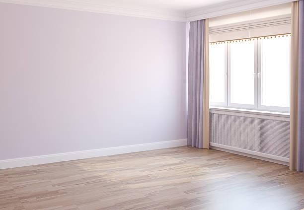 Daylight illuminates an empty room ready to be furnished stock photo