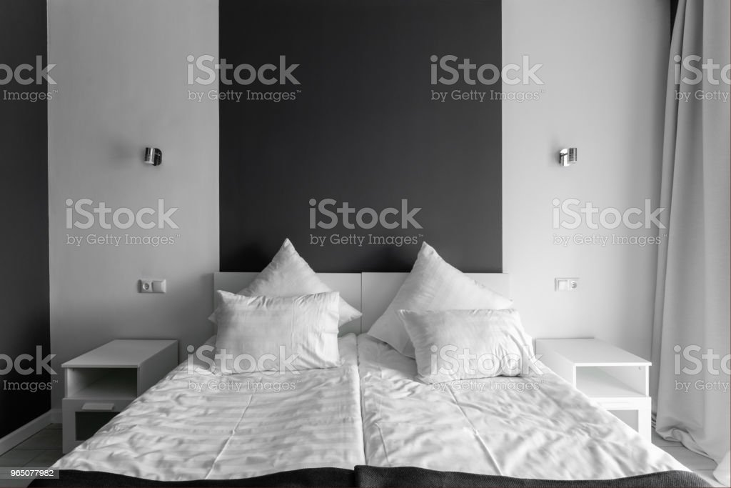 daylight morning. Hotel standart room. modern bedroom with white pillows. simple and stylish interior. royalty-free stock photo