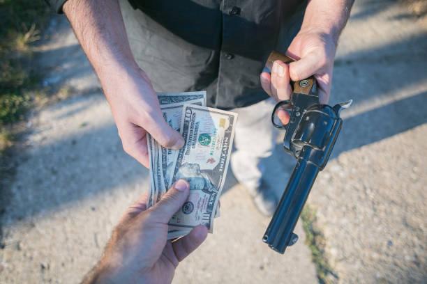 daylight robbery on street by criminal stock photo