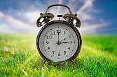 istock Daylight saving time concept with Alarm clock. 1201496129