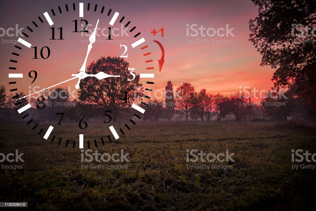 Daylight Saving Time. DST. Wall Clock going to winter time. Turn time...