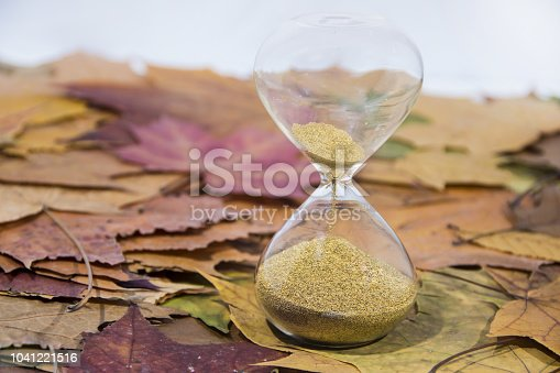 607492948 istock photo Daylight Saving Time. Wall Clock going to winter time. Autumn abstraction. 1041221516