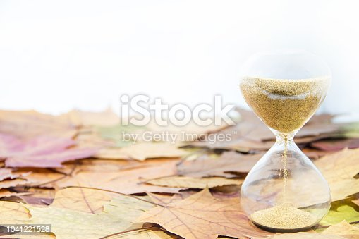 607492948 istock photo Daylight Saving Time. Wall Clock going to winter time. Autumn abstraction. 1041221528